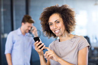 Colleagues communicating on mobile phone