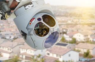 Closeup of Drone Camera and Sensor Pod Module Above Neighborhood