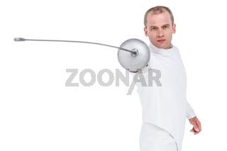Swordsman practicing with fencing sword
