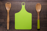 wooden spoon and cutting board on the table