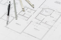Engineer Pencil, Ruler and Compass Resting on House Plans