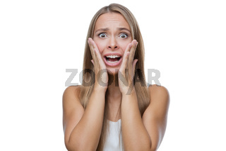 Portrait of surprised woman on white background