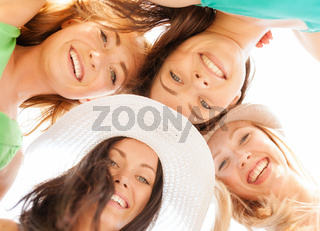 faces of girls looking down and smiling