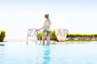 Pretty woman enjoying a swimming pool