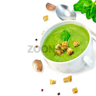 Soup puree with croutons and spoon in bowl