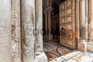 Pillars and wooden door of The Church of the Holy Sepulchre.