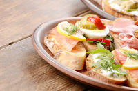 Open sandwiches with salmon, eggs, mussels and jamon