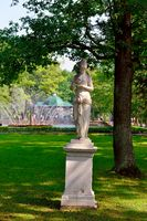 Marble statue and fountain in Peterhof garden,