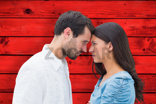 Composite image of angry couple staring at each other