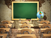 Empty classroom with school desks, chairs and chalkboard.