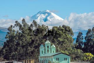 Cotopaxi volcano over the San Jaloma Church and Village, Andes of Ecuador