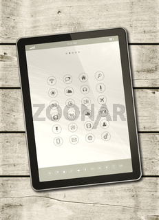 Digital tablet PC on a white wood table