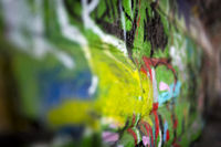 Graffiti of bright colors on the wall of a railway underpass