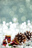 Christmas gift box on sparkles background