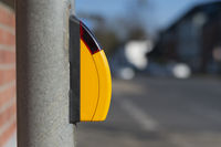 Yellow button for a traffic light