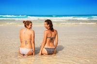 women in bikini on a beach