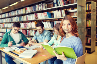 students with books preparing to exam in library