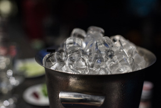 Ice bucket with ice cubes