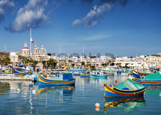 marsaxlokk harbour and traditional mediterranean fishing boats in malta