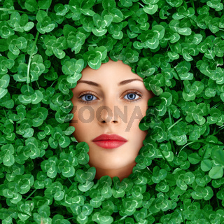 Woman face surrounded by grass
