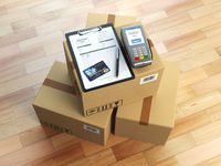 Cardboard box, clipboard with receiving form and pos terminal and credit card. Delivery concept.