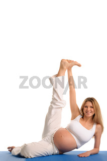 pregnant woman lying down and practicing yoga