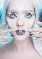pretty woman with snow queen makeup and nails