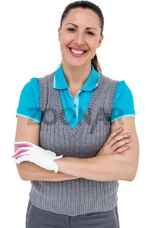 Golf player standing on white background