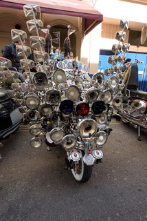 LONDON - ENGLAND 1ST MAY 2016 - A parked Lambretta Scooter covered in mirrors and lights in Soho