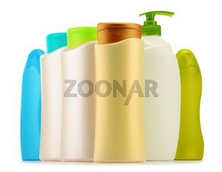 Plastic bottles of body care and beauty products isolated on white