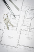Engineer Pencil, Ruler and Keys Resting On House Plans