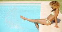 Girl in Bikini Swimsuit Relaxing in Swimming Pool