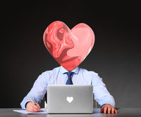 businessman with heart instead of his head