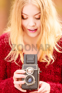 Pretty woman with old vintage camera.