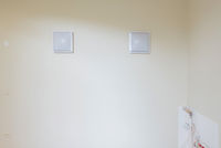 White blank picture frames over white wall