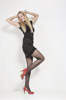 woman in black mini dress