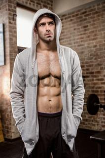 Focused man wearing hood