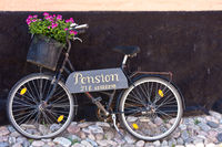 Advertising on the bike for a pension in Ärösköbin