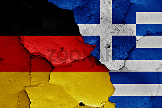 flags of Germany and Greece painted on cracked wall