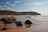 Praia do Amado - rocky coastline in Algarve / Portugal