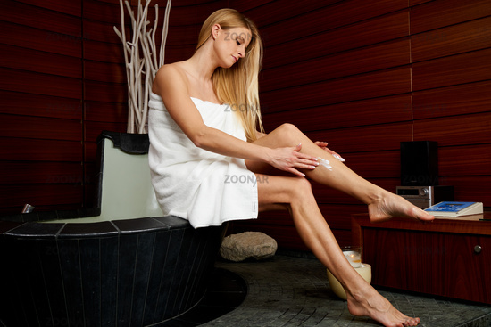 Young woman lubricating in spa