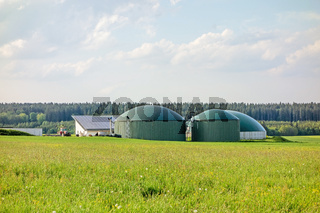 Biogas plant on green meadow