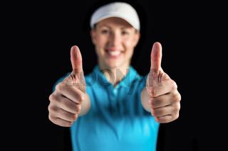 Sportswoman posing on black background