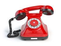 Vintage red telephone isolated on white background. Retro styled telephone