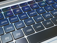 Web design development concept, Programming or SEO  termnes on the laptop keyboard.