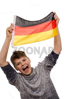 Teenager mit einer Fahne von Deutschland