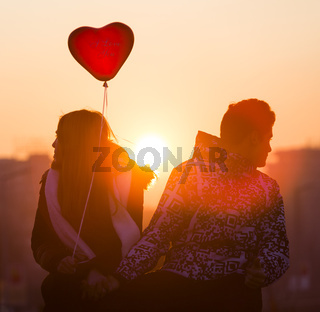 Young couple in love balloon heart