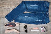 Aerial  view of woman#39;s jeans and accessories