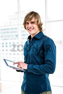 Hipster businessman using tablet