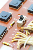 Close up of electronic components on a obsolete printed-circuit board